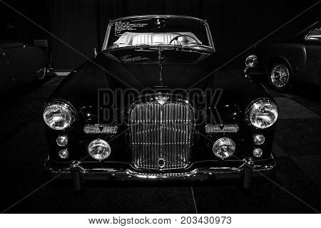 MAASTRICHT NETHERLANDS - JANUARY 08 2015: British sports car Alvis Three Litre TD21 DHC - Series I 1961. Black and white. International Exhibition InterClassics & Topmobiel 2015