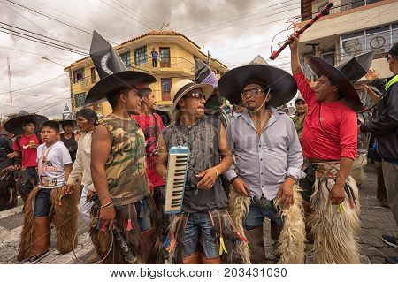 June 24 2017 Cotacachi Ecuador: a group of indigenous kichwa men participating at an Inti Raymi parade at summer solstice