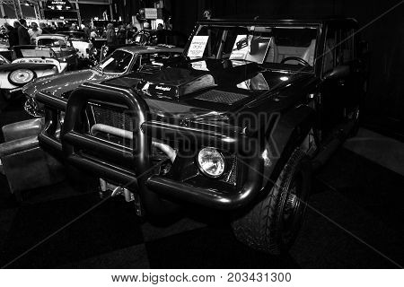 MAASTRICHT NETHERLANDS - JANUARY 08 2015: SUV Lamborghini LM002. The LM002 is also the first four-wheel drive model manufactured by Lamborghini. Black and white. International Exhibition InterClassics & Topmobiel 2015