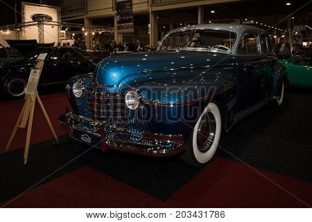 MAASTRICHT NETHERLANDS - JANUARY 08 2015: Full-size car Oldsmobile 98 De Luxe 1941. International Exhibition InterClassics & Topmobiel 2015