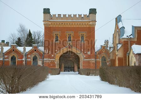 Fragment of a old complex of Imperial Gothic stables in the cloudy February afternoon. Peterhof