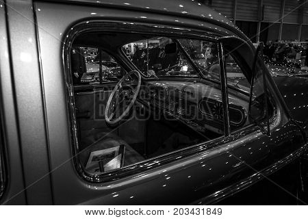 MAASTRICHT NETHERLANDS - JANUARY 08 2015: Cabin of a full-size car Oldsmobile 98 De Luxe 1941. Black and white. International Exhibition InterClassics & Topmobiel 2015