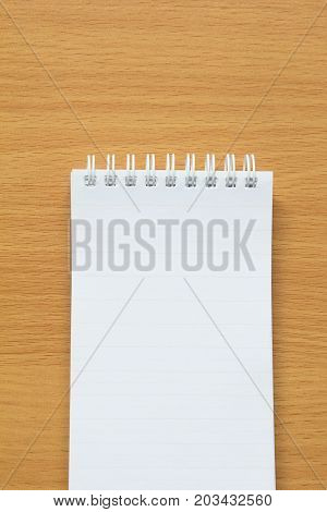 Blank lined paper on wood table for writing remind for to do list