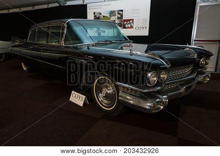 MAASTRICHT NETHERLANDS - JANUARY 08 2015: Full-size luxury car Cadillac Series 75 Fleetwood 6700 Limousine 1959. International Exhibition InterClassics & Topmobiel 2015