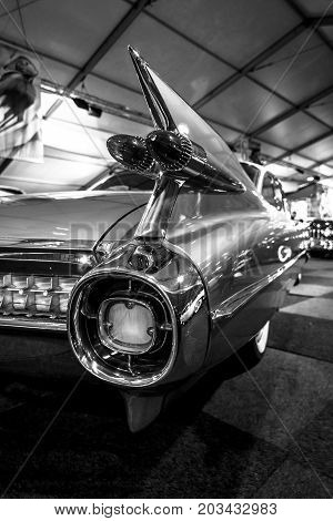 MAASTRICHT NETHERLANDS - JANUARY 08 2015: The rear brake lights a full-size luxury car Cadillac Sixty Special Fleetwood 1968. Black an white. International Exhibition InterClassics & Topmobiel 2015