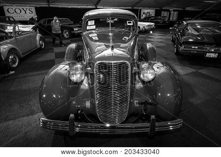 MAASTRICHT NETHERLANDS - JANUARY 08 2015: Full-size luxury car Cadillac Fleetwood Series 70. Black and white. International Exhibition InterClassics & Topmobiel 2015