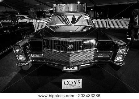 MAASTRICHT NETHERLANDS - JANUARY 08 2015: Full-size luxury car Cadillac series 75 Fleetwood 1968. Black and white. International Exhibition InterClassics & Topmobiel 2015