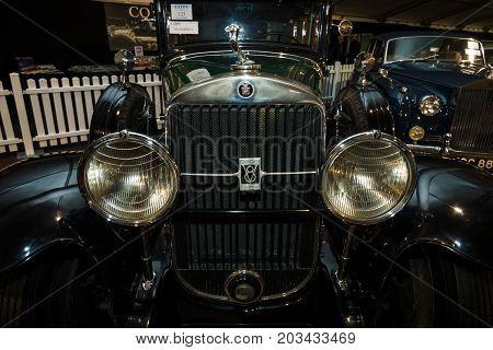 MAASTRICHT NETHERLANDS - JANUARY 08 2015: Radiator grill and headlamps of a oldtimer Cadillac 341-A Fleetwood 1929. International Exhibition InterClassics & Topmobiel 2015
