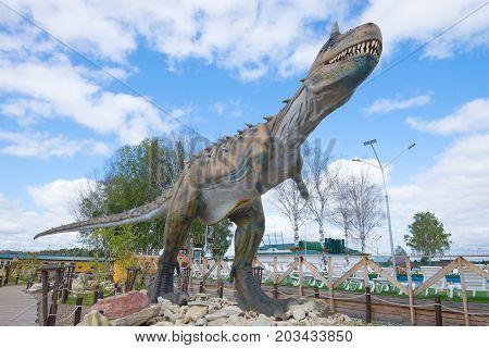 KIROV, RUSSIA - AUGUST 30, 2017: A sculpture of a predatory dinosaur - carnotaurus close up. Theme children's park