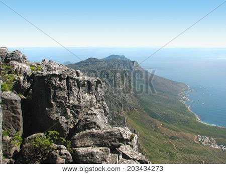 RUGGED ROCKS AND STEEP CLIFFS IN THE CAPE OF GOOD HOPE NATURE RESERVE ON THE SOUTHERN TIP OF THE CAPE  OF THE CAPE PENINSULA, IN SOUTH AFRICA