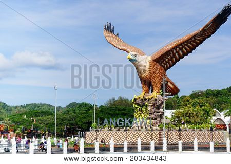 Langkawi, Malaysia - 3rd May 2017: Shot of Langkawi's famous landmark the Eagle square, Dataran Lang, from the sea in front of it. The blue cloudy sky and beautiful blue water show how Malaysia's beauty