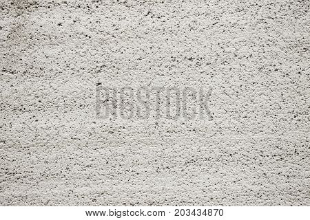 Close up of a porous concrete gray wall empty urban background building