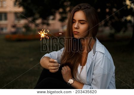 Beautiful Young Girl With Bengal Fire Sparkler On The Street