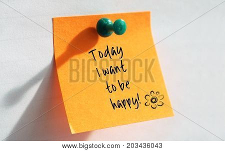 Today I want to be happy written on a orange sheet