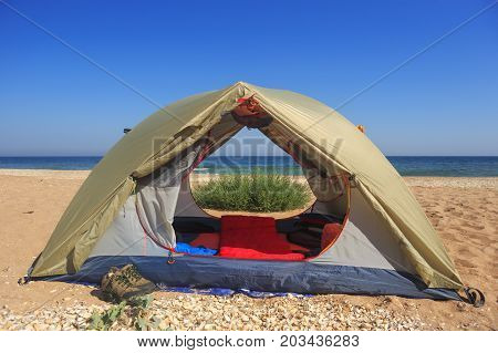 Travel Tent On Wild Sandy Seashore