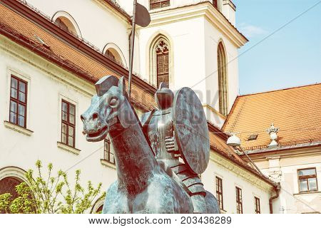 Equestrian statue of margrave Jobst of Luxembourg and Church of St. Thomas Brno Moravia Czech republic. Yellow photo filter.
