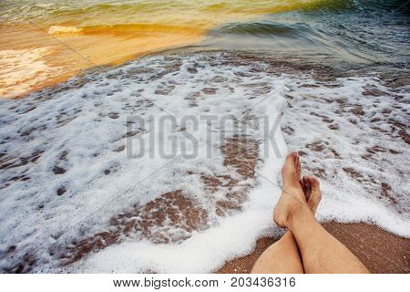 Male Legs At The Background Of Surf Sea Waves