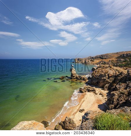Wild Seashore With Fancy Weathered Cliffs