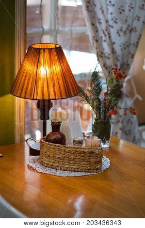 Cozy Interior With Table And Lamp