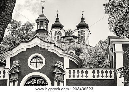 Calvary in old mining town Banska Stiavnica Slovak republic. Religious architecture. Travel destination. Black and white photo.