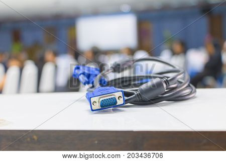 old dirty VGA tech cable connector of computer on table white Blur meeting room background