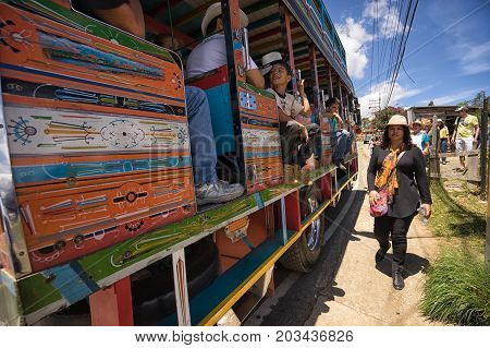 August 6 2017 Medellin Colombia: old colourful buses called 'chiva' used for transportation and as party bus during the annual flower festival in Santa Elena