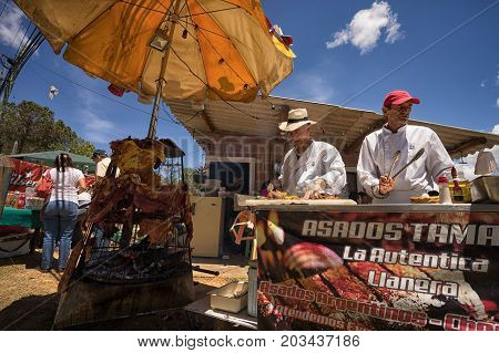 August 6 2017 Medellin Colombia: food vendors during the flower festival offering barbecued meat variety on the street
