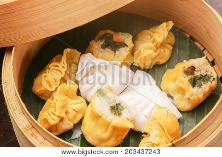 High angle view of cooked dumplings inside of bamboo steamer