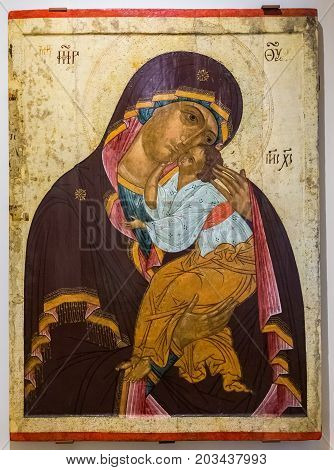 Veliky Novgorod Russia - August 17 2017: Antique Russian orthodox icon. Our Lady of Tenderness painted on old wooden board 1460s