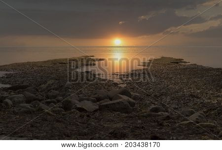 Kimmeridge Bay Jurassic Coast shoreline Dorset UK sunset