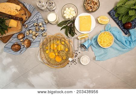 Overhead Of Ingredients Frittata Quishe Vegeterian Diet Meal. Eggs In Bowl, Quail Eggs, Milk, Cheese