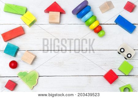 Wooden cubes and a pyramid on a white wooden background. Copy space