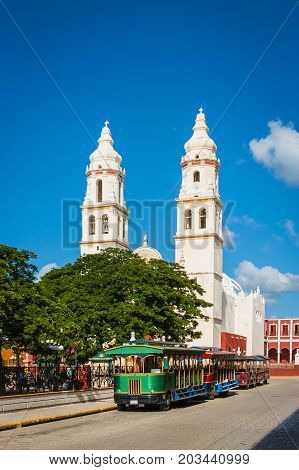 A Streetcar In Front Of The Campeche Cathedral, Mexico.