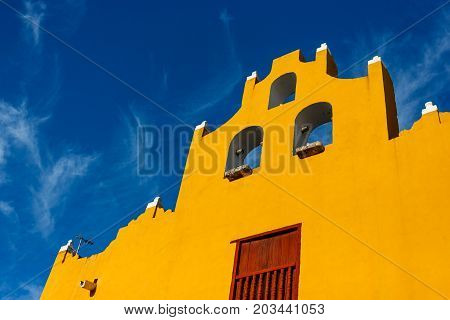 Colored Buildings Over A Blue Sky In Campeche, Mexico.