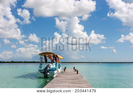 Boat At The Pier With Clouds And Blue Water At The Laguna Bacalar, Chetumal, Quintana Roo, Mexico.