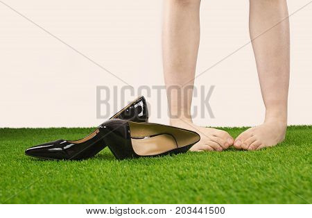 Young Woman Took Off Her Shoes For Relax On The Lawn,lower Legs Close Up,female Took Off Her High-he