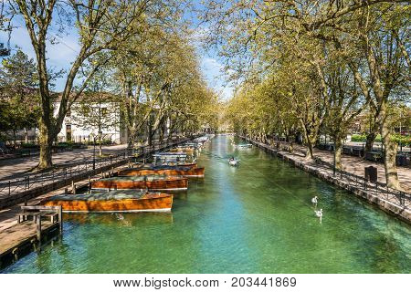 Annecy France - May 25 2016: View of river and boats from Pont des Amours (Bridge of Love) in Annecy France. Annecy is a commune in the Haute Savoie department of the Rhone-Alpes region in south-eastern France.