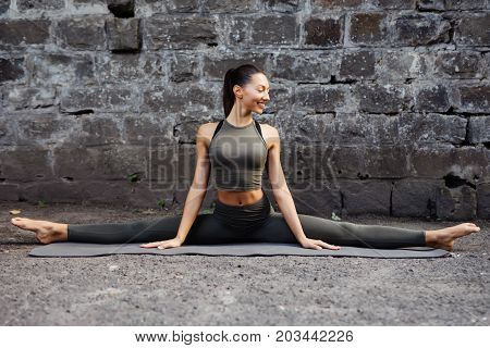 Sporty Beautiful Young Woman Practicing Yoga Hanumanasana Working Out, Wearing Sportswear, Outdoor F