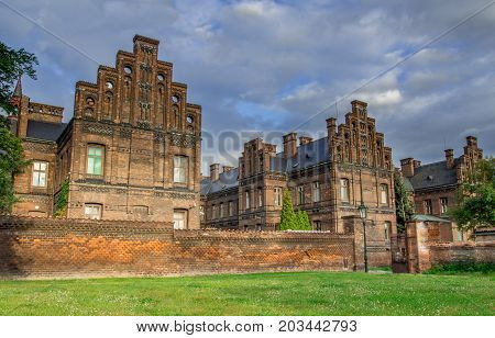 Old redbrick building which is a hospital. Looks like old English castle or manor. Autumn picture. New Town of Prague Czech Republic