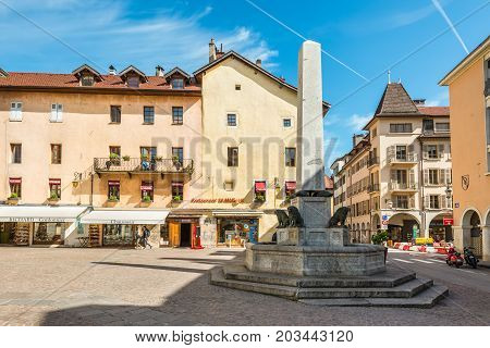 Annecy France - May 25 2016: Fontaine in the square Place Notre Dame in Annecy France. Annecy is a commune in the Haute Savoie department of the Rhone-Alpes region in south-eastern France.