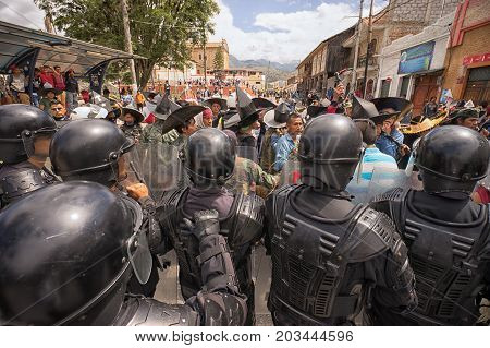 June 24 2017 Cotacachi Ecuador: riot police steps in at the Inti Raymi parade at summer solstice