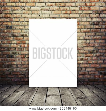 Empty poster (210*297) in old interior with brick wall and wood floor