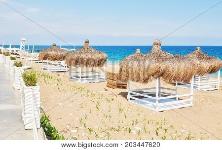 White chairs on the beach resort famous Amara Dolce Vita Luxury Hotel. Resort. Tekirova-Kemer. Turkey