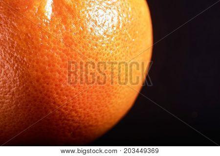 macro fresh orange peel on a black background