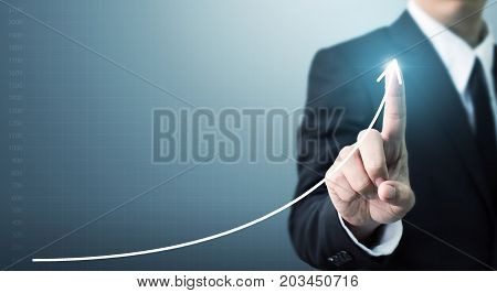 Businessman hand touching point graph growth or increase business chart Growing up revenue and development concept
