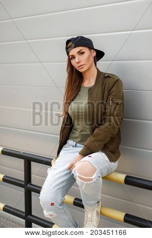 Young Beautiful Girl With Freckles In A Baseball Cap In A Street Style In A Fashionable Military Gre