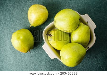 Pears fruit in a bowl on green background,healthy fruit