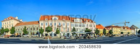 Vilnius, Lithuania - August 13, 2017: Beautiful cityscape of Vilnius old town and bright blue sky,  Lithuania. Vilnius city panorama. Street panorama near Vilnius city hall.