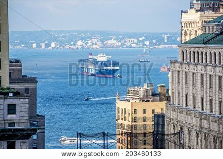 NEW YORK-MAY 5 - September 7 - The CMA CGM T Roosevelt the largest cargo ship ever to enter an East coast port after the completed raising of the Bayonne Bridge in the NY Harbor on September 7 2017.