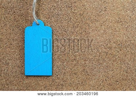 Blue empty wood sign on wooden cork background for input text in your want and have copy space.